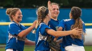 East Meadow's Sam Reyes, right, celebrates with teammates