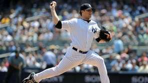 Yankees starting pitcher Phil Hughes (65) throws during
