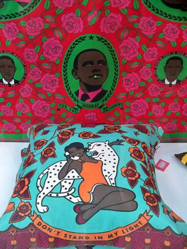 A throw pillow depicting Michelle Obama and wallpaper