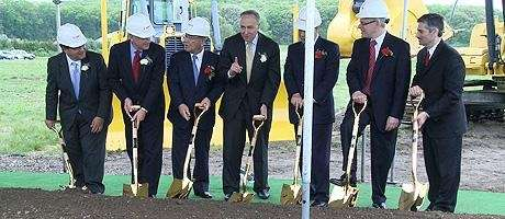 Canon executives and politicians break ground in Melville.