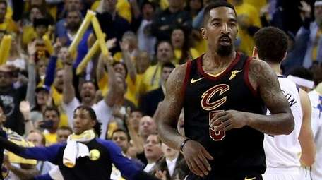 J.R. Smith of the Cavaliers reacts as time