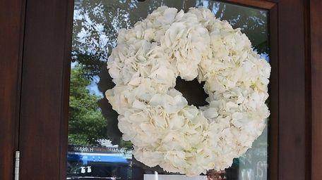 Flowers on the door of Bernard Krupinski's Cittanuova