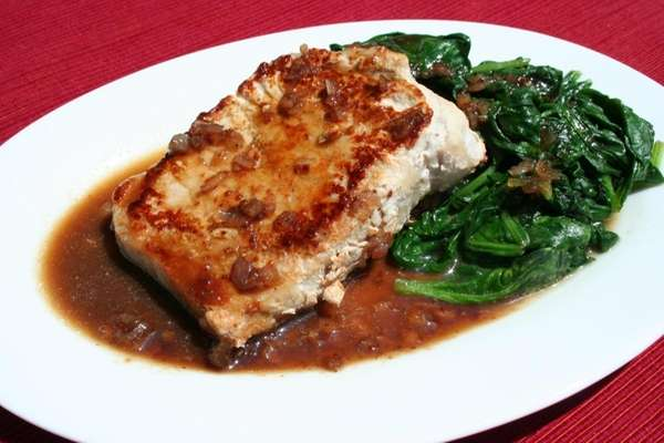 Pork chops and spinach with honey mustard sauce.