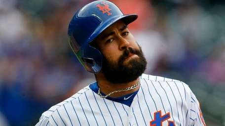 Luis Guillorme of the Mets reacts after flying