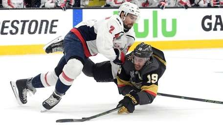 Reilly Smith of the Golden Knights is checked