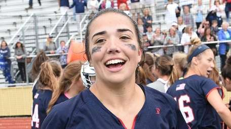 Cold Spring Harbor midfielder Grace Tauckus reacts after