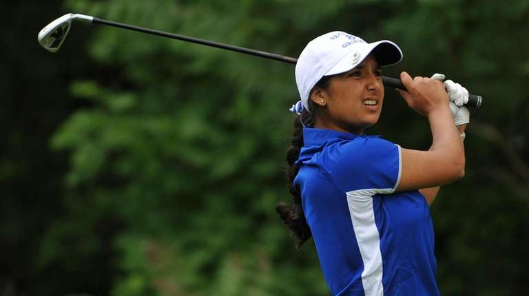 Malini Rudra of Syosset tees off on the