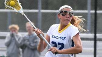 Mattituck midfielder Riley Hoeg drives to the net