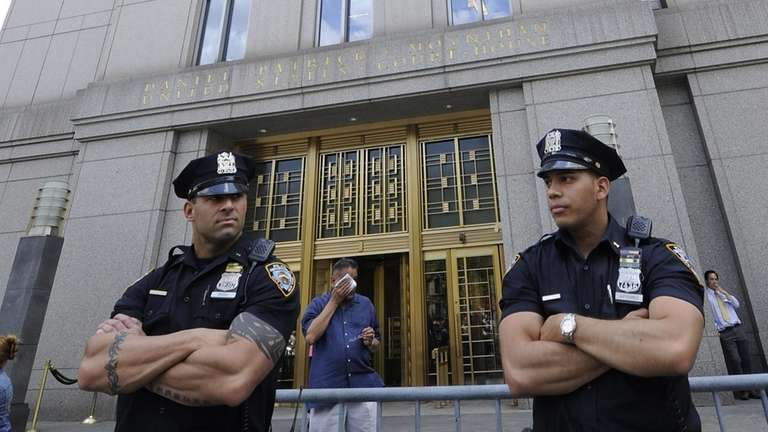 New York City Police stand guard outside of
