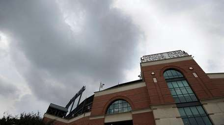Storm clouds hover over Oriole Park at Camden