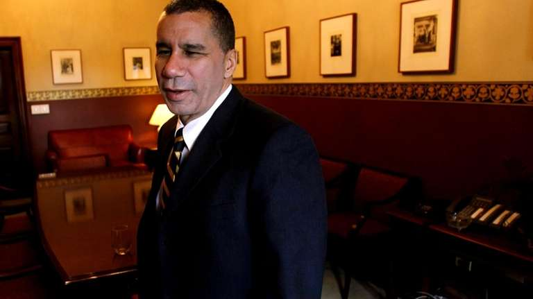 Gov. David Paterson stands in his office in