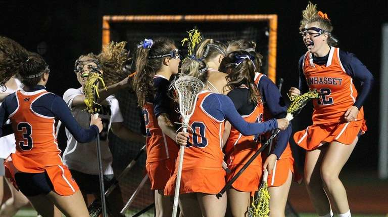 Manhasset celebrates its win in the Long Island
