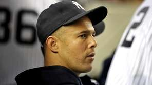 Yankees' pitcher Javier Vazquez watches the game from