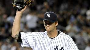Yankees' pitcher, A.J. Burnett acknowledges the cheers of