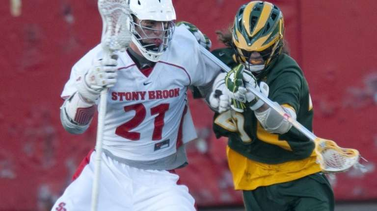 (L) Stony Brook University's Kevin Crowley drives for