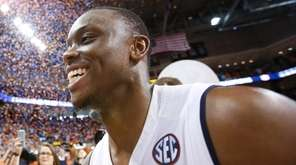 Auburn guard Mustapha Heron celebrates a 79-70 win