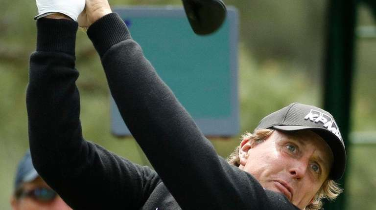 Phil Mickelson hits a drive on the 18th