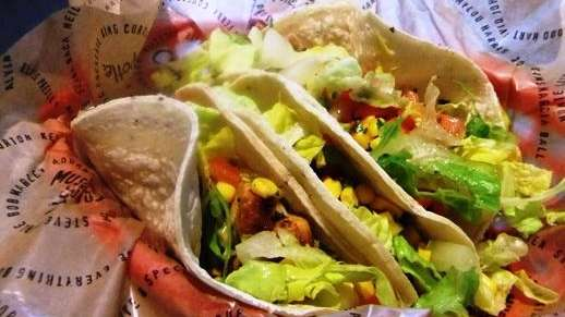 A trio of soft corn tacos at Chipotle
