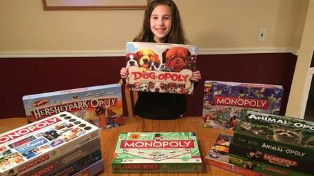 Kidsday reporter Dana Stumpf and her Monopoly collection.