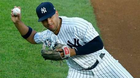 Gleyber Torres of the Yankees throws for an