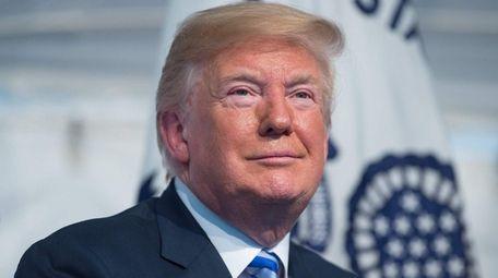President Donald Trump, seen here on Friday, raises