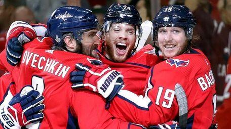 Capitals defenseman John Carlson, center, celebrates his goal