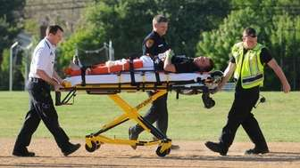 Emergency services personnel tend to injured Longwood High