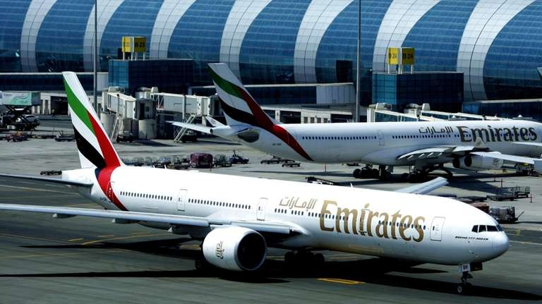 An Emirates airline passenger jet taxis on the