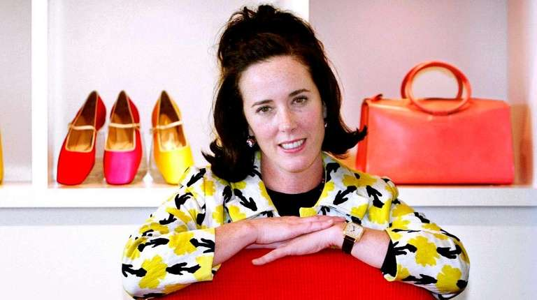 Kate Spade poses with handbags and shoes from