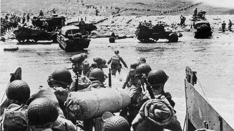 American soldiers and supplies arrive on the shore