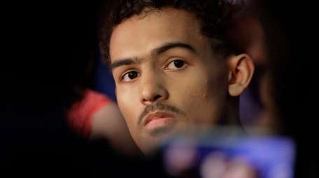 Trae Young from Oklahoma listens to a question