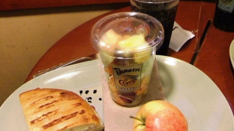 Cuban chicken panini, fresh fruit cup and an