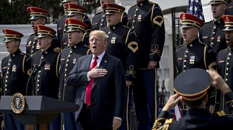 President Donald Trump sings the national anthem at