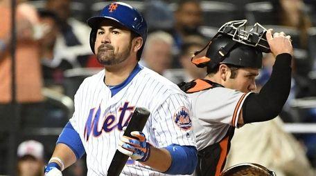 Mets first baseman Adrian Gonzalez reacts after striking