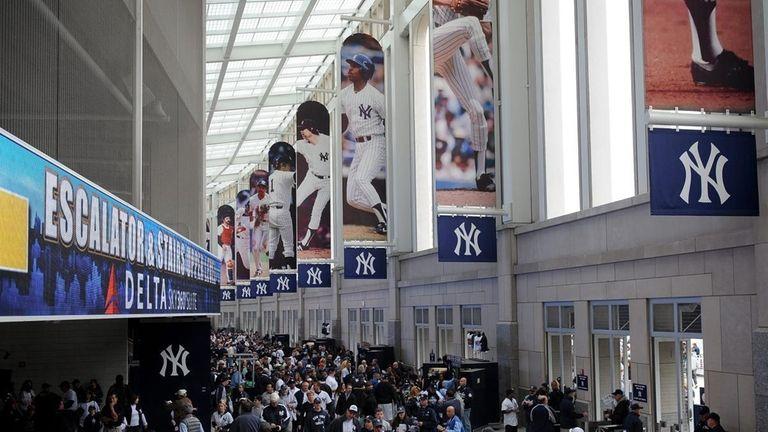 Baseball fans make their way through the Great