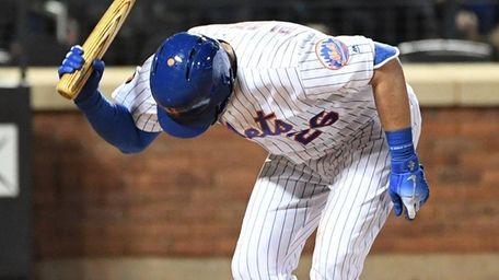 Mets catcher Kevin Plawecki slams his bat after