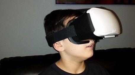 Kidsday reporter Evan Sanders wears his VR headset.