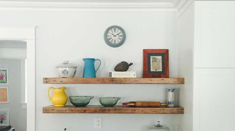 Reclaimed wood floating shelves from a renovation project