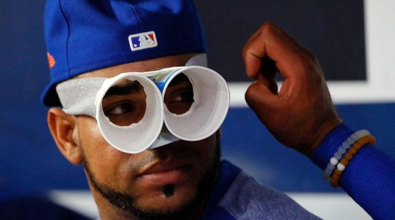 Yoenis Cespedes jokes around in the Mets dugout