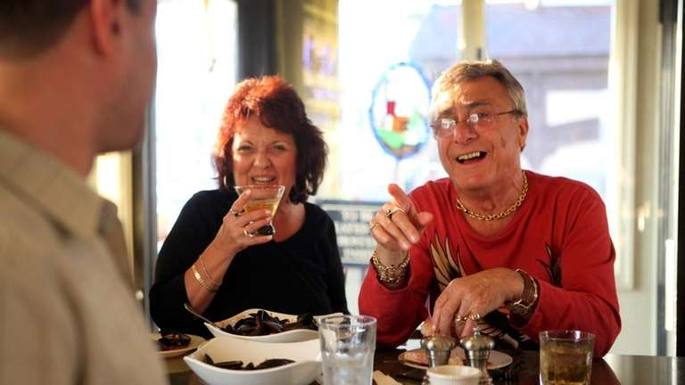 Joanne and Herb Handler of Freeport chat at