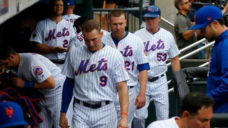 Mets players leave the dugout after a loss