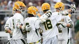 Ward Melville players celebrate a goal against Niskayuna