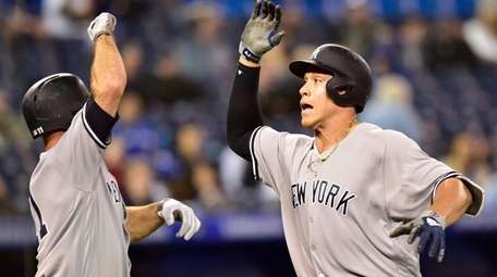 The Yankees' Aaron Judge celebrates his home run