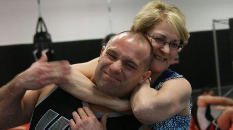 Janice Serra, right, playfully puts her son, Matt,