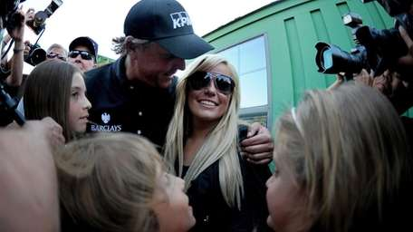 Phil Mickelson celebrates with his wife Amy