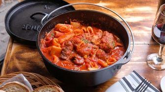 """Sunday sauce"" features pork ribs, sausage, braciola, meatballs,"