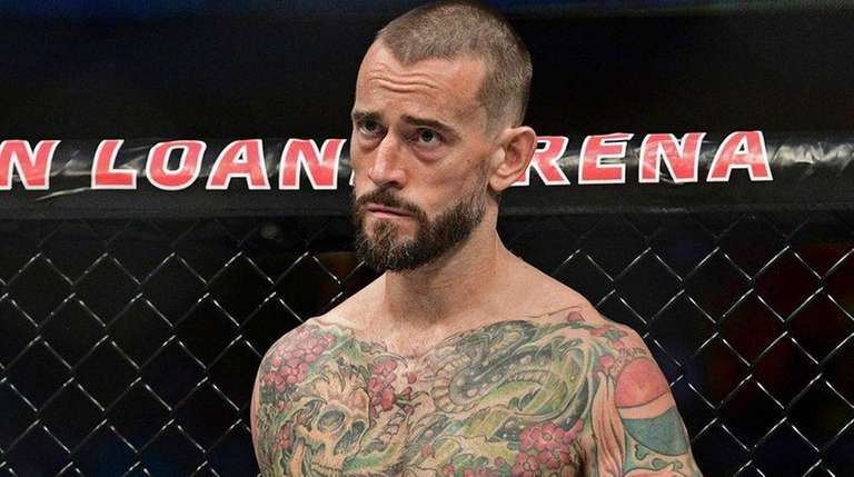 CM Punk stands in his corner before a