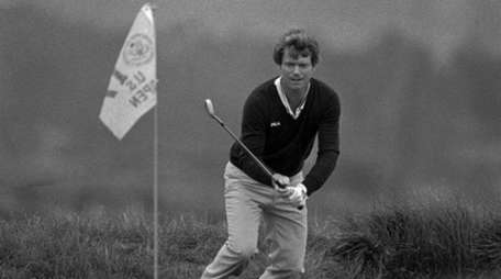 Tom Watson watches his ball go in the
