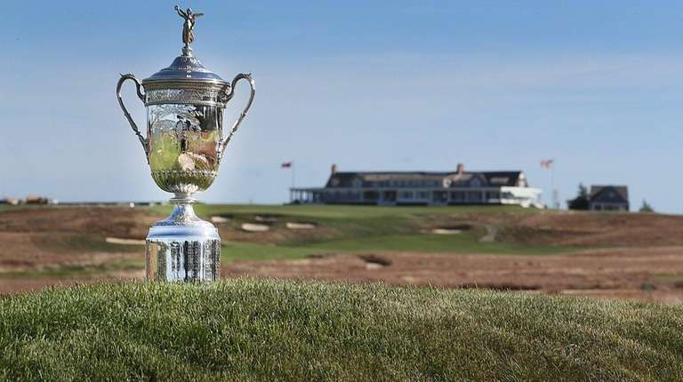 The US Open trophy with the clubhouse in