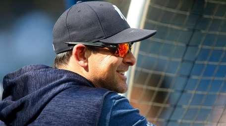 Yankees manager Aaron Boone watches batting practice at